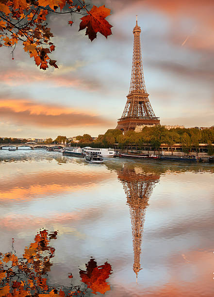 Water view of the Eiffel Tower on an autumn day in Paris stock photo