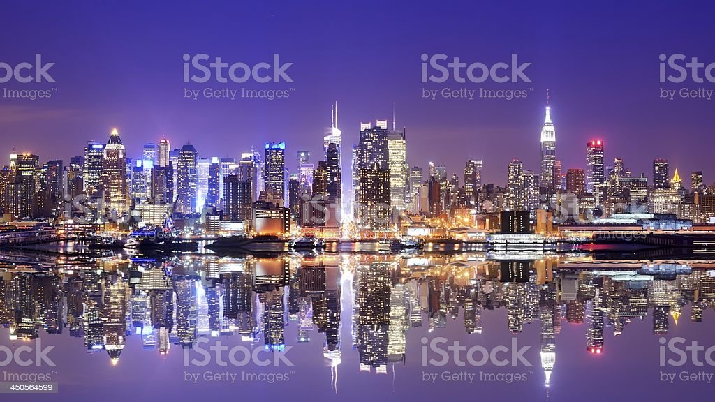 Water view of the Manhattan skyline at dusk with reflection royalty-free stock photo