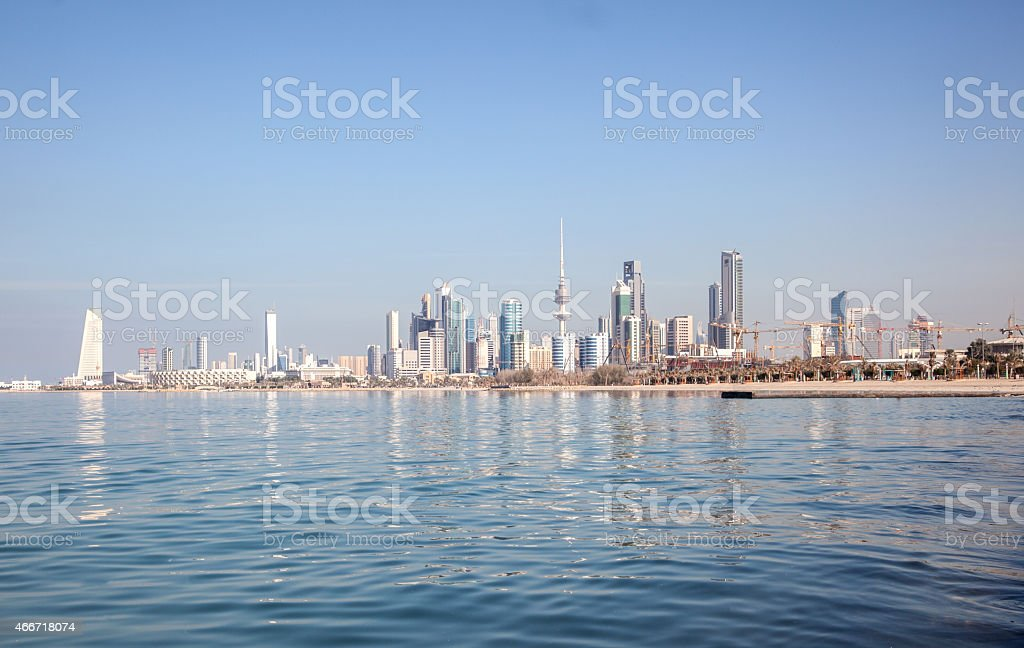 Water view of the skyline of Kuwait City under a clear sky stock photo