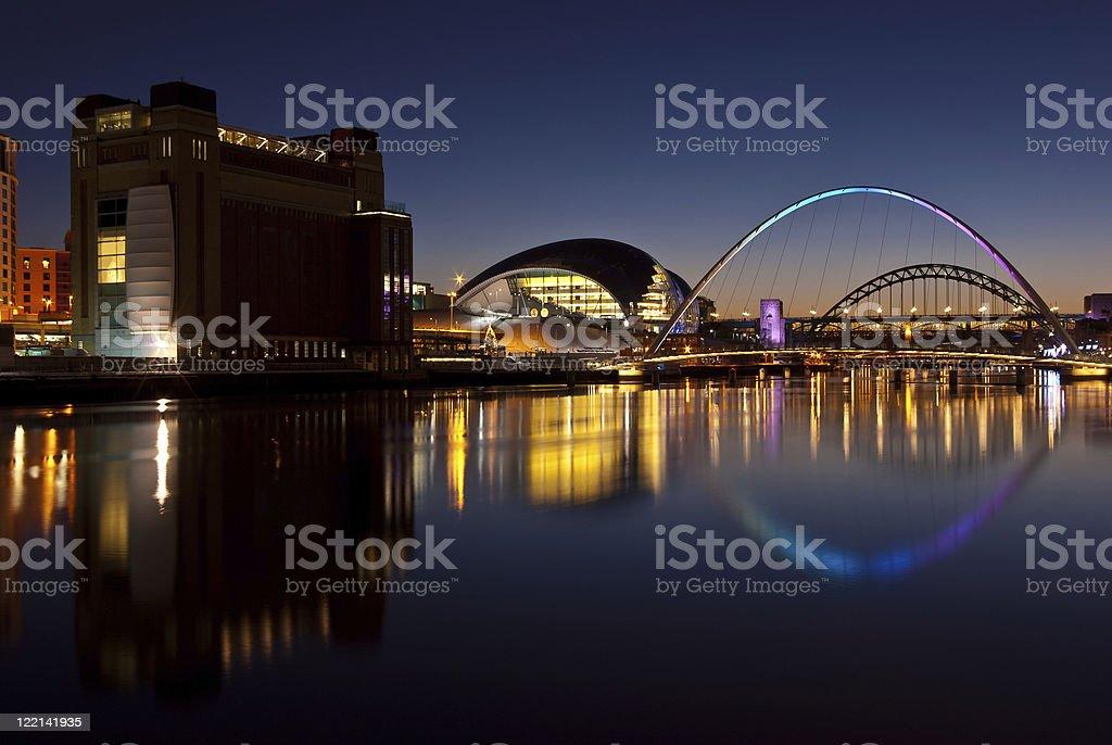 Water view of Tyne bridges during sundown stock photo