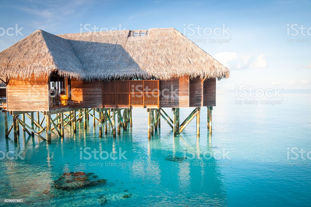 Water villa in the ocean stock photo
