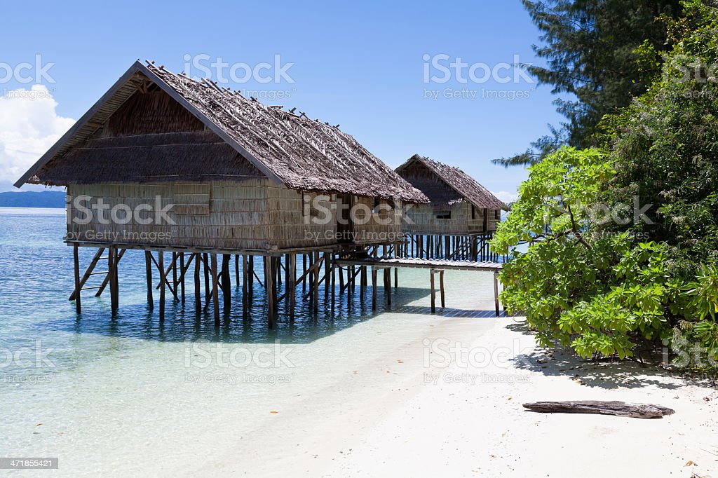 Water Village, Traditional Style Bungalows, Kri Island, Raja Ampat, Indonesia royalty-free stock photo