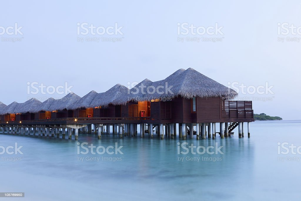 Water Villas at Sunrise. Welcome to Paradise! royalty-free stock photo