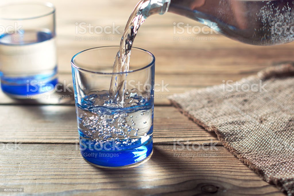 Water was poured into the beaker - foto de stock