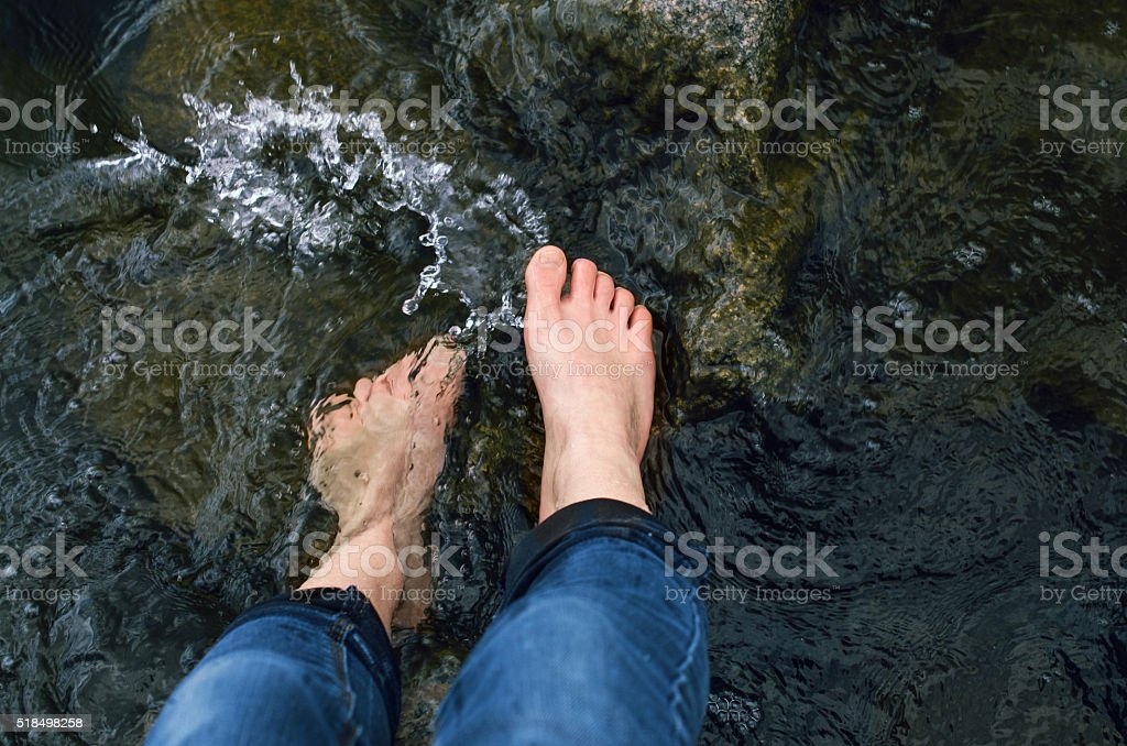 Water washes feet stock photo