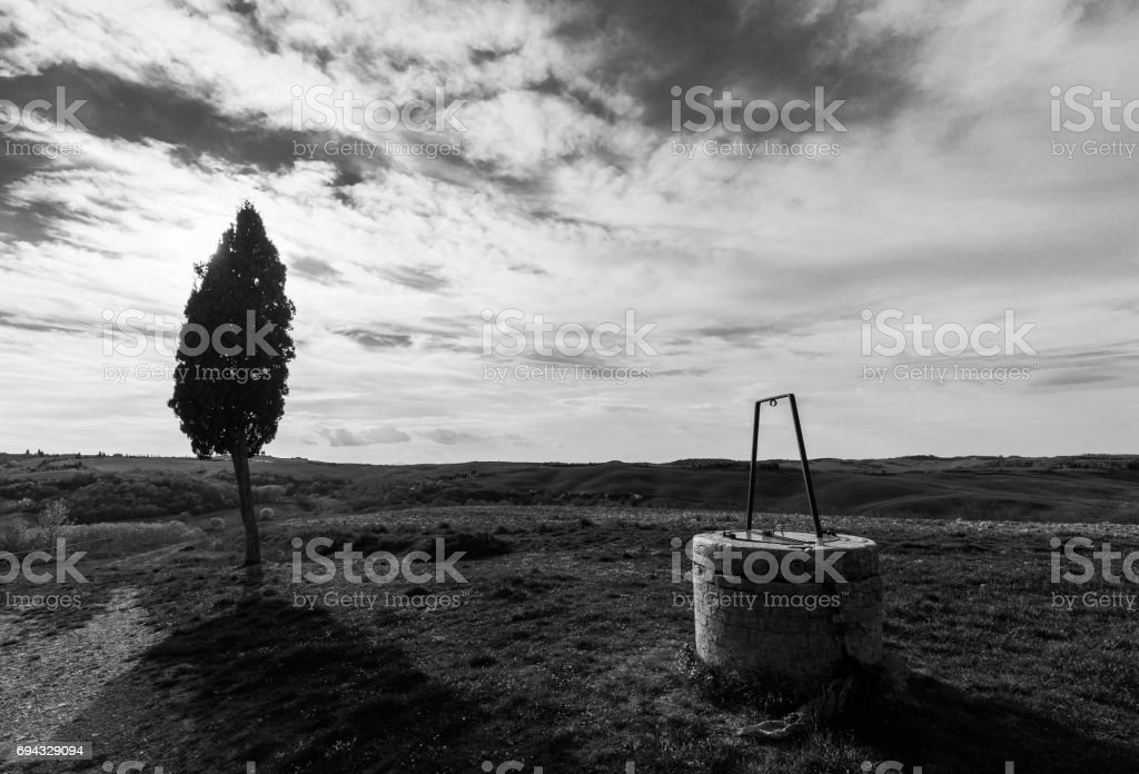 Water well and tree stock photo