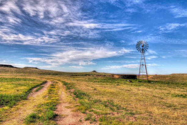 Water well and Windmill on the Texas Plains A windmill pumps water from a well in the Texas Panhandle plains amarillo texas stock pictures, royalty-free photos & images