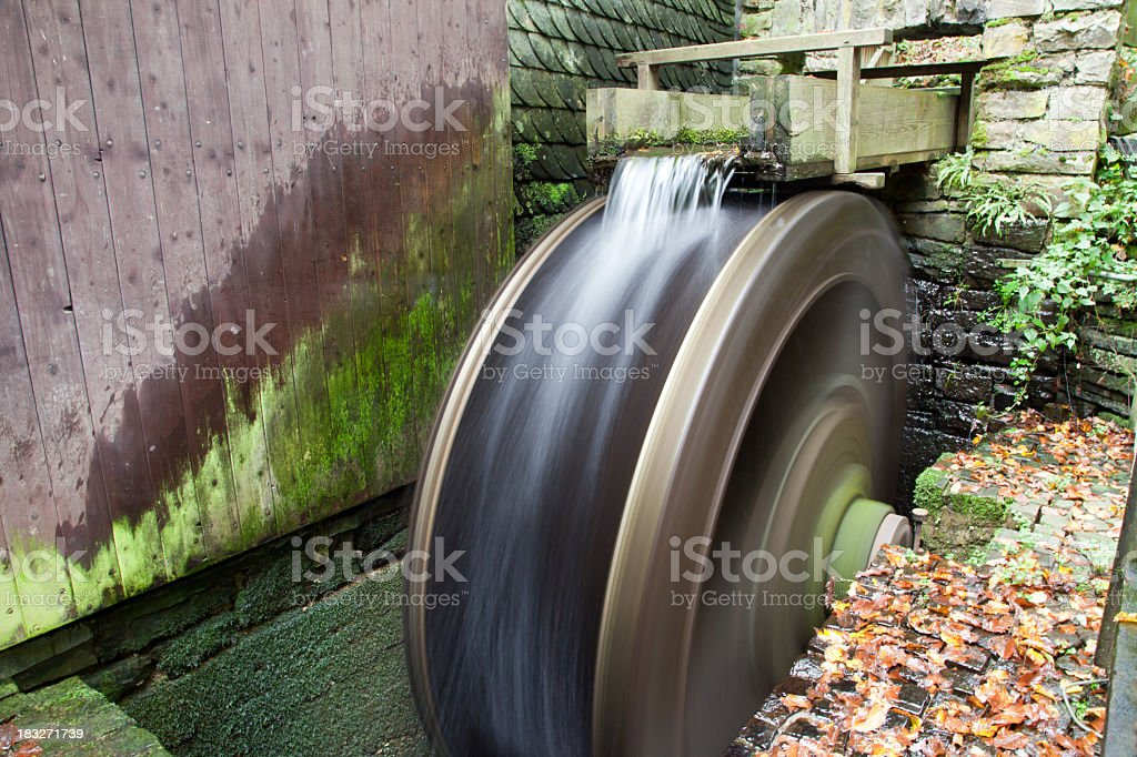 Water wheel in motion at rustic location royalty-free stock photo