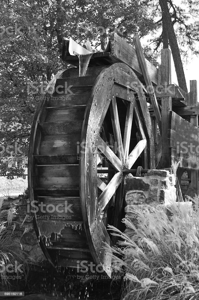 Water Wheel Working water wheel on black and white. Flour Mill Stock Photo
