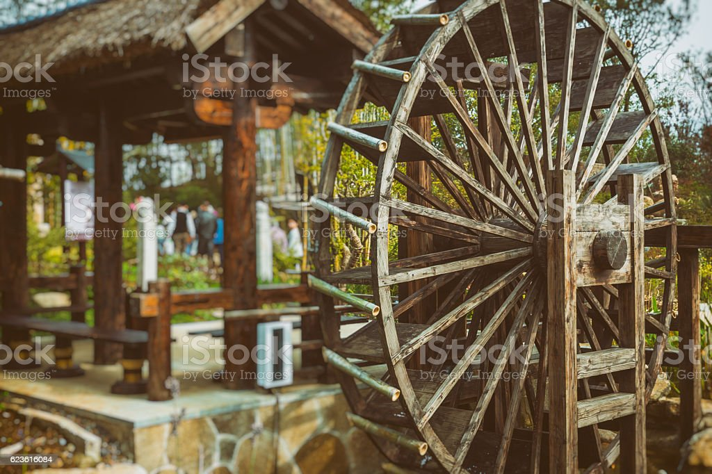 Water Wheels On River Amidst Trees stock photo