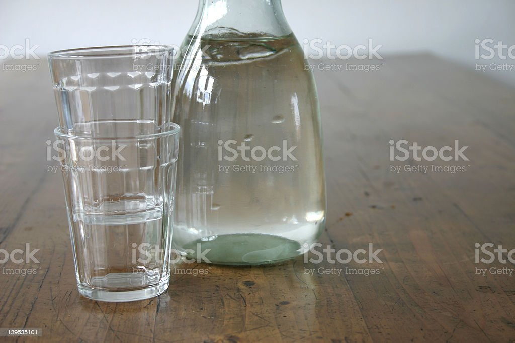 waterbottle and glasses royalty-free stock photo
