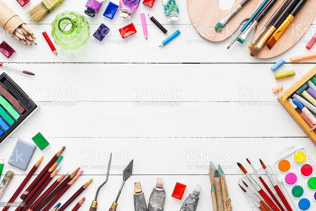Watercolor and oil paints, brushes, pencils, pastel crayon on table. royalty-free stock photo