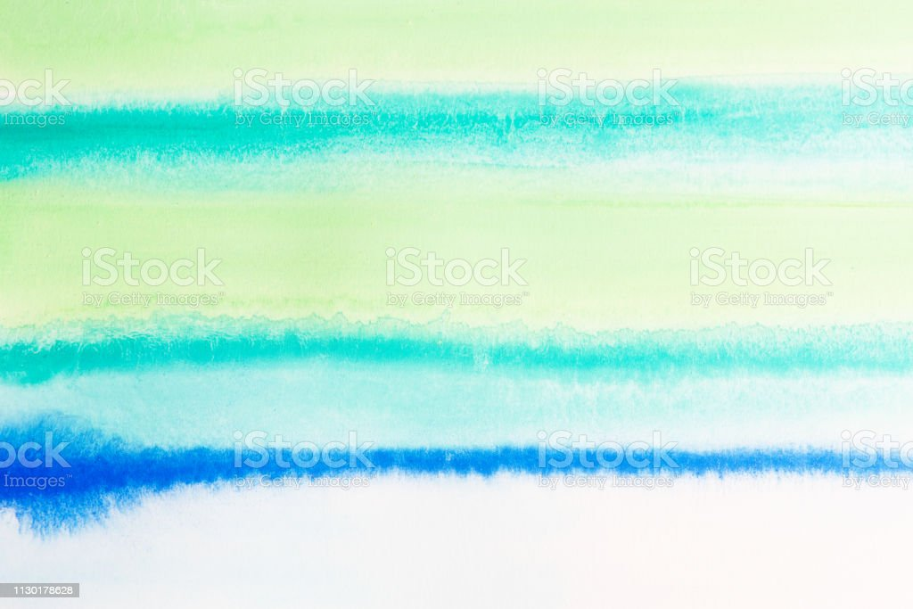 Watercolor art with drips on textured paper stock photo