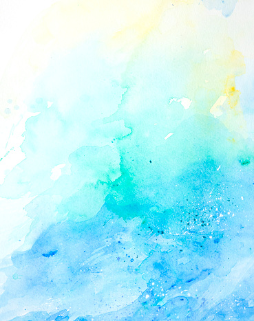 Abstract wet blue green and yellow watercolor background on white watercolor paper. My own work.