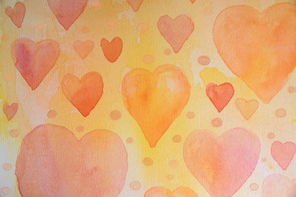 Watercolor hearts and circles hand painted on canvas stock photo