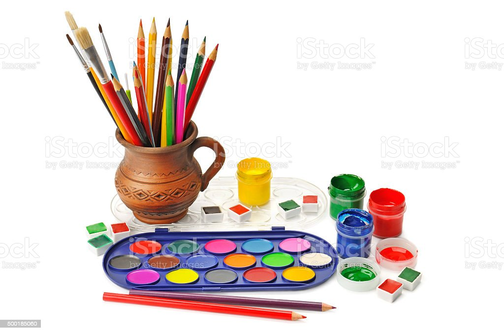 watercolor paint and colored pencils stock photo