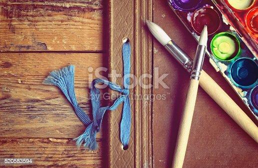 istock watercolor paint, brushes, album 520583594