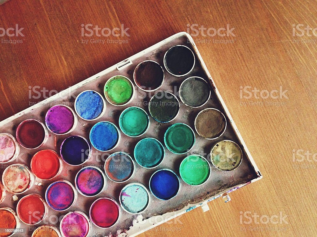 Watercolor Paint Palette on Wooden Surface royalty-free stock photo