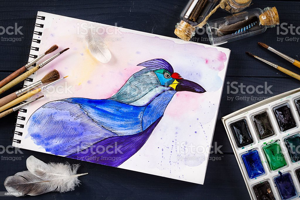 Watercolor Painting Of Blue Bird And Artistic Tools On Table