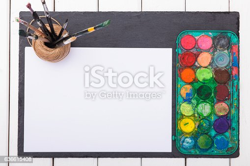 istock Watercolor paints  brushes for painting and blank white paper 636615408