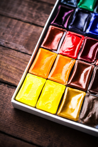 577949148 istock photo Watercolor paints on vintage wooden background close up. Art 506930191