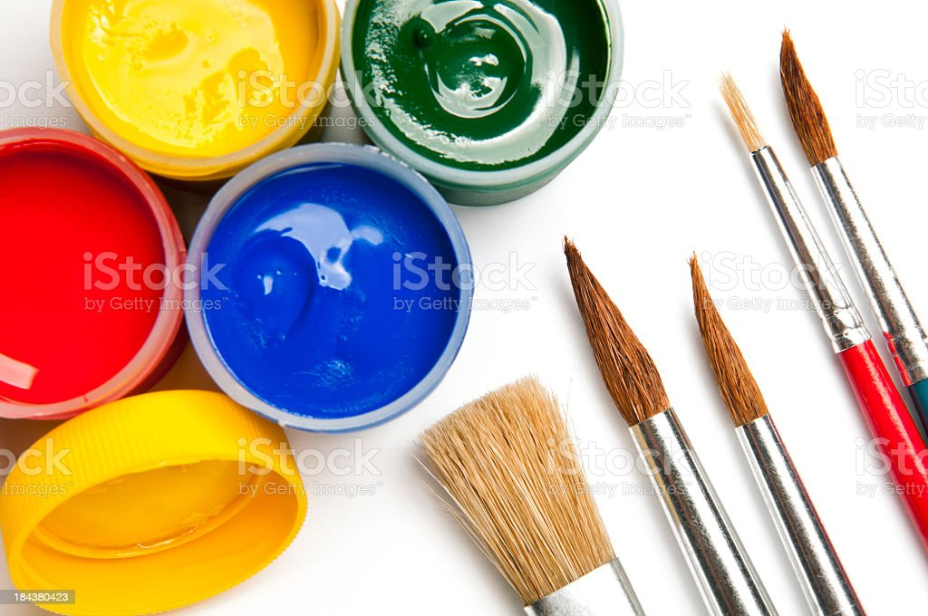 Watercolor paints, poster paints in mini cans, paintbrushes, isolated royalty-free stock photo