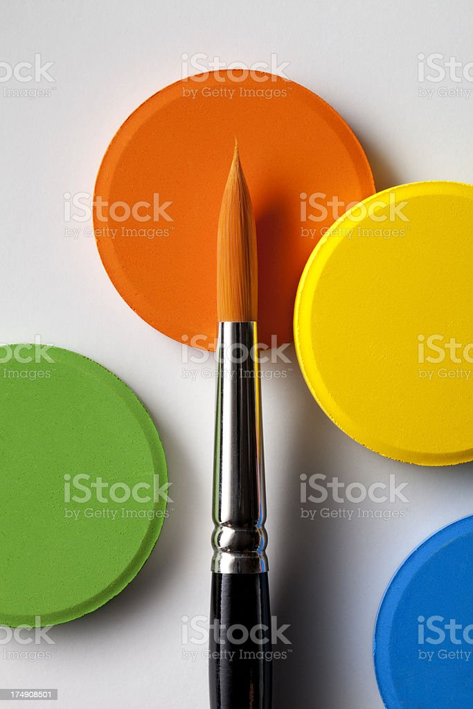 Watercolor paints with brush royalty-free stock photo