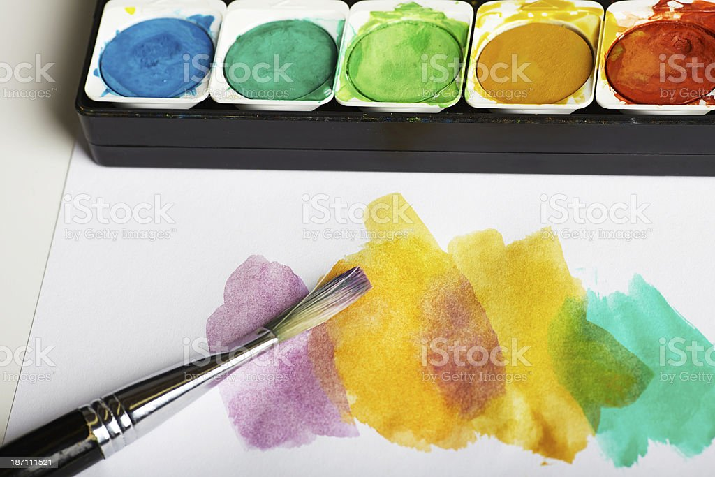 Watercolor paints with paintbrush stock photo
