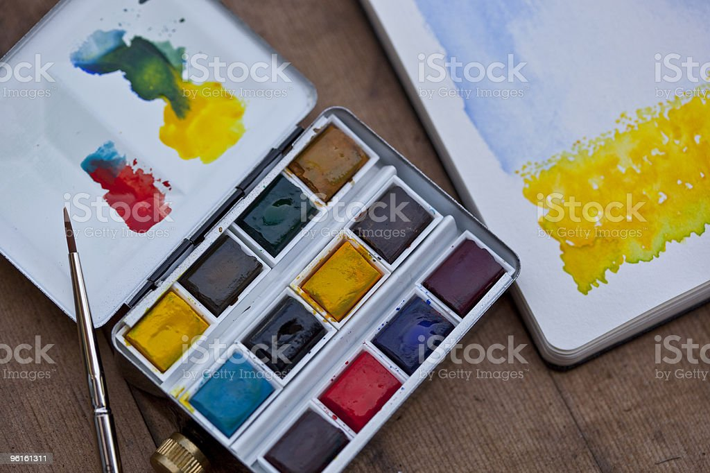 Watercolor palette and painting royalty-free stock photo