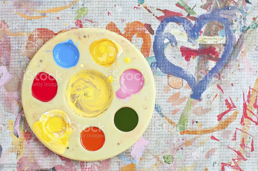 Watercolor palette on the painted white canvas stock photo