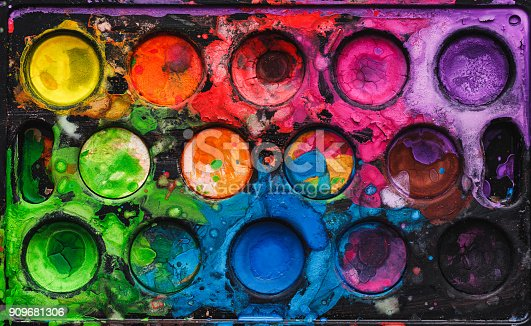istock Watercolor palette with mixed colors 909681306