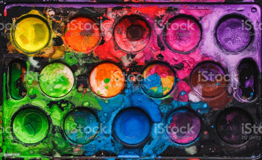 Watercolor palette with mixed colors stock photo