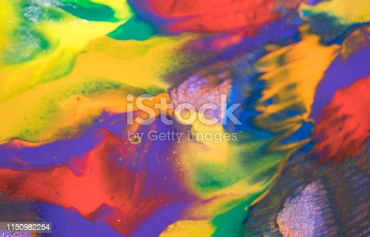 935916462istockphoto Watercolor Textured Background.Macro close up of different color oil paint. colorful acrylic 1150982254