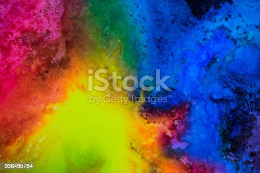 istock Watercolor with rainbow galaxy splatter. 936495784