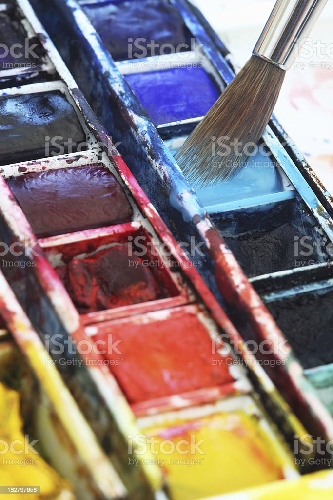 Watercolors and paintbrush close-up royalty-free stock photo