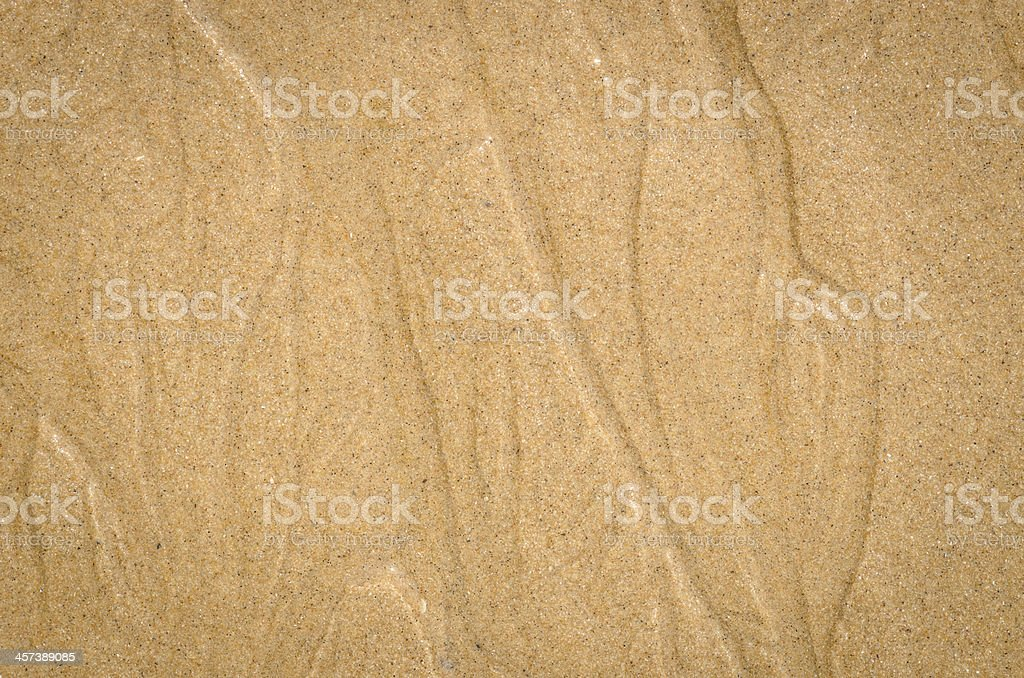 Watercourse on wet sand pattern of a beach stock photo