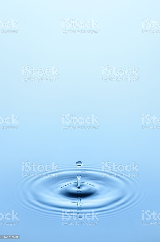Waterdrop vertical shoot stock photo
