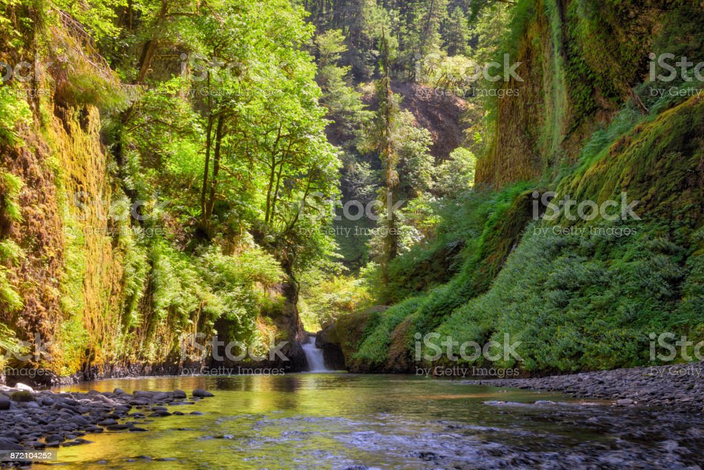Waterfall along Eagle Creek in Columbia River Gorge summer season in OR USA stock photo
