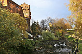 Walking path along the river in city in autumn.  Waterfall at Mølla.