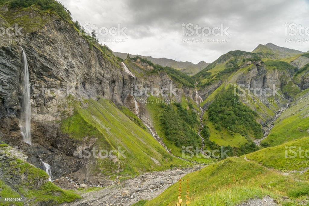 waterfall amphitheater in the Swiss Alps stock photo
