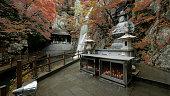 A waterfall and a statue of Buddha at Hongryongsa temple