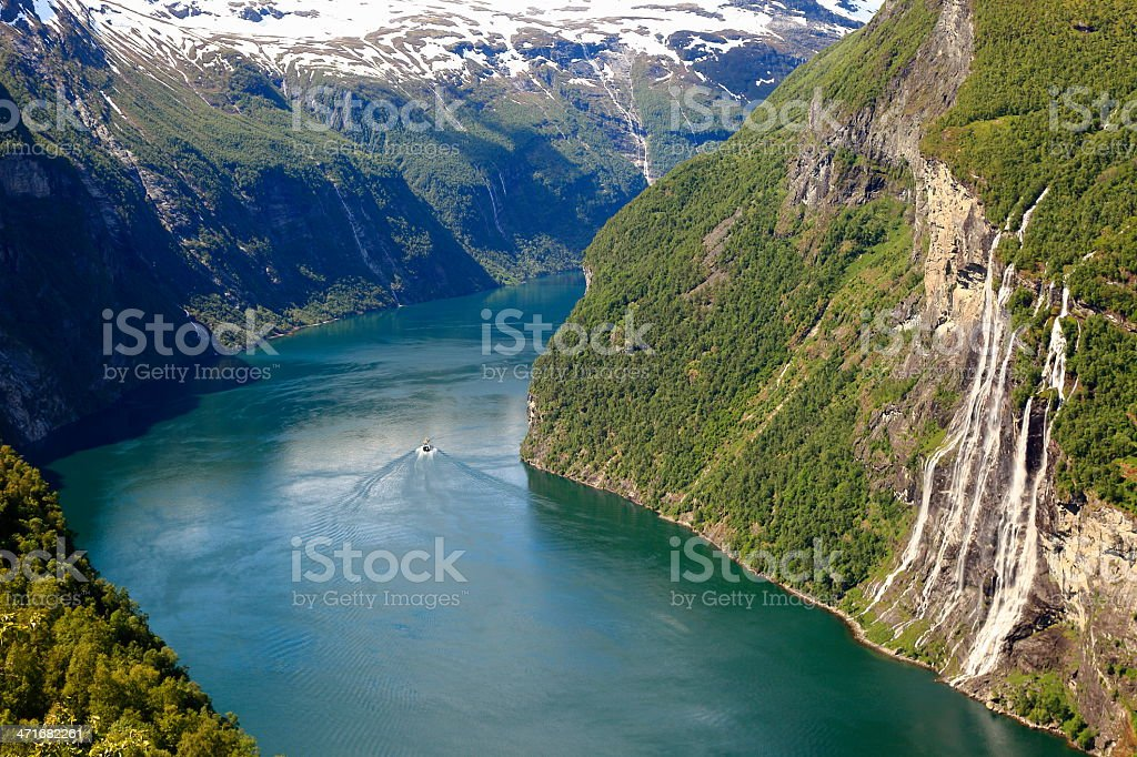 Waterfall and Geiranger fjord with boat cruise, Norway, Scandinavia stock photo