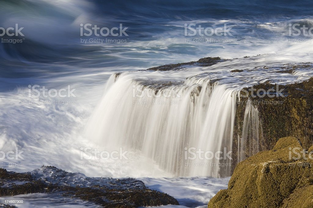 Waterfall and ocean waves at Acadia National Park's Schoodic Point stock photo