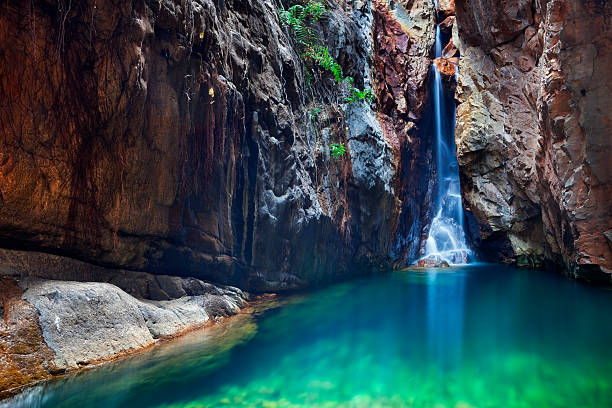 waterfall and plunge pool in el questro gorge, western australia - western australia stock pictures, royalty-free photos & images