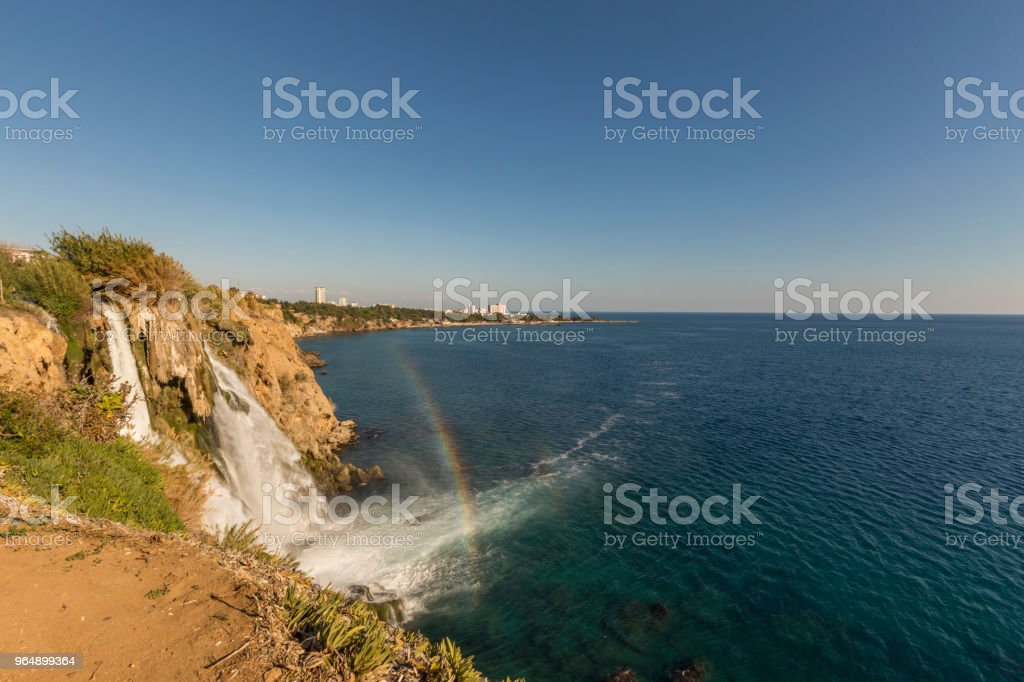 Waterfall and rainbow royalty-free stock photo
