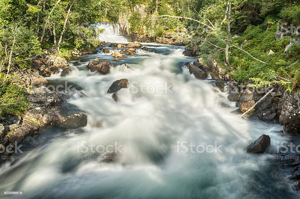 Waterfall and river in Norway stock photo