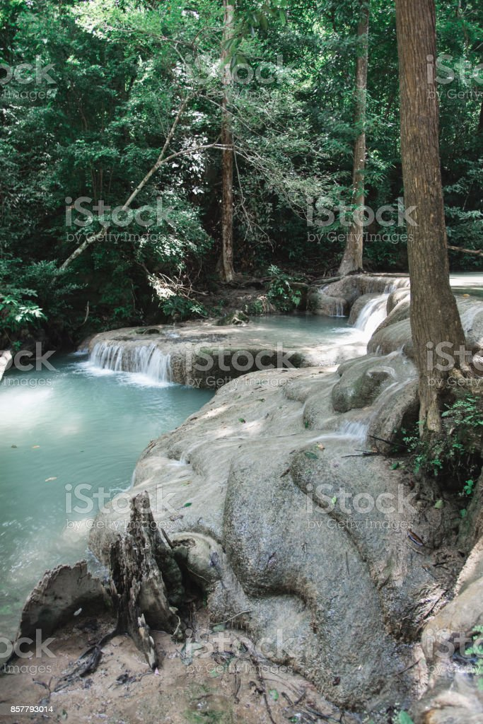 Waterfall and Rocky Surface Along Erawan Falls Hiking Trail stock photo