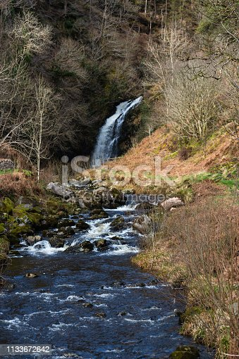A small waterfall known as the Grey Mare's Tail in Dumfries and Galloway