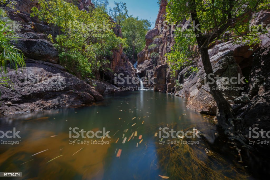Waterfall and swimming hole in Northern Territories Australia stock photo