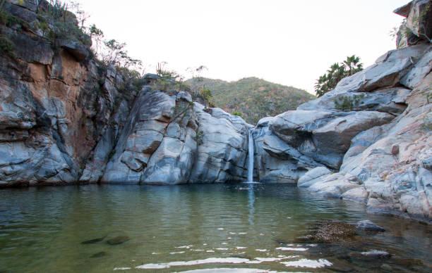 Waterfall and swimming pool at Cascada Sol Del Mayo on the Baja California peninsula in Mexico BCS stock photo